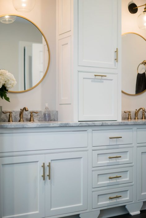 a beautiful bathroom with custom cabinetry