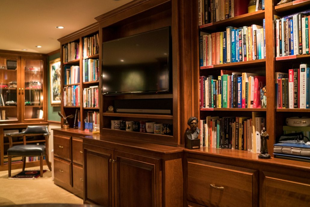 a home office with built-in bookshelves