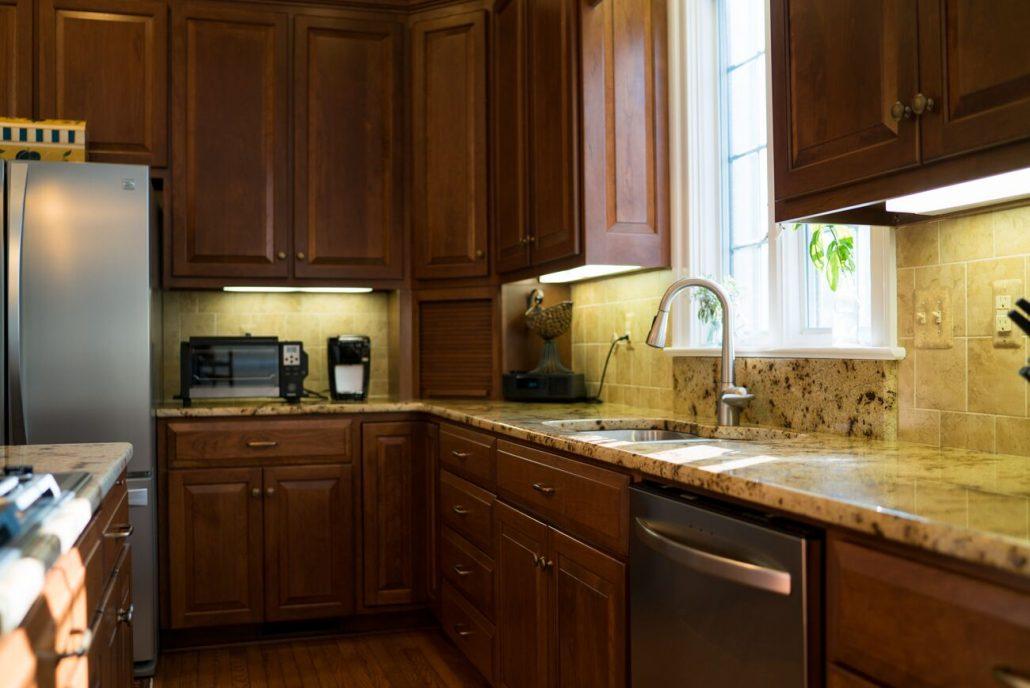 granite countertop on cherry cabinets