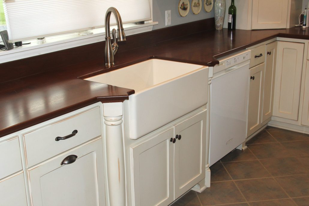 farm sink in antique white cabinetry