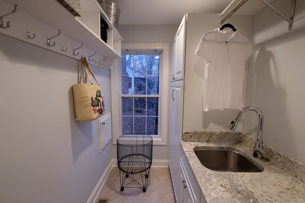 white high-end laundry room cabinetry