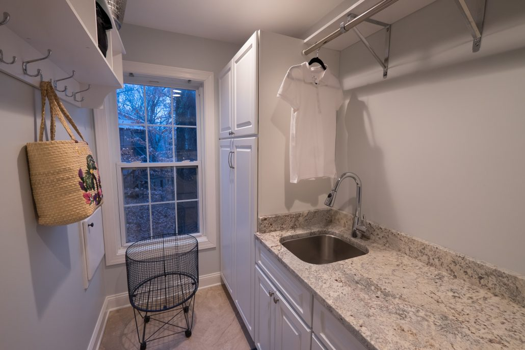 laundry room coordinating with kitchen